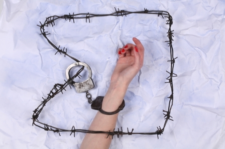 hand in handcuff and barbedwire